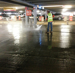 Parking garage deck water repellent sealer application