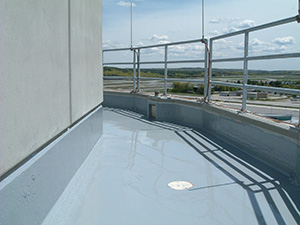 Pedestrian traffic-bearing urethane concrete deck coating